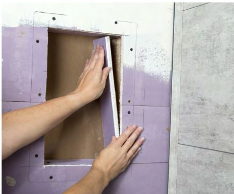 Construct a framed box between the wall studs