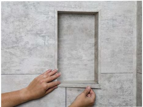 Apply bead of sealant at the corners of the niche